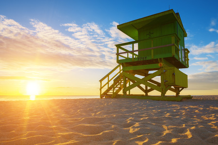 lifeguard tower: Miami South Beach sunrise with lifeguard tower and coastline, USA.