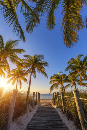 View of passage to the beach at sunrise- Key West, USA photo