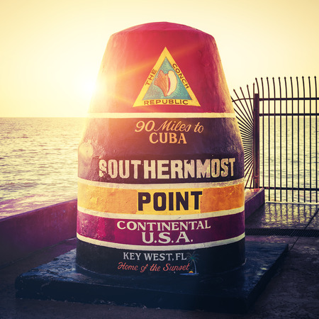 southernmost: Florida Buoy sign marking the southernmost point at sunset Editorial