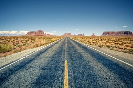 desert highway: Desert highway leading into Monument Valley, Utah, USA Stock Photo