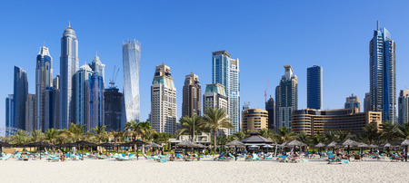 Panoramic view of famous skyscrapers and jumeirah beach in Dubai. UAE