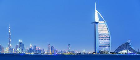 View of Dubai skyline by night, UAE.