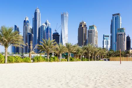 dhabi: Horizontal view of skyscrapers and jumeirah beach in Dubai. UAE Stock Photo