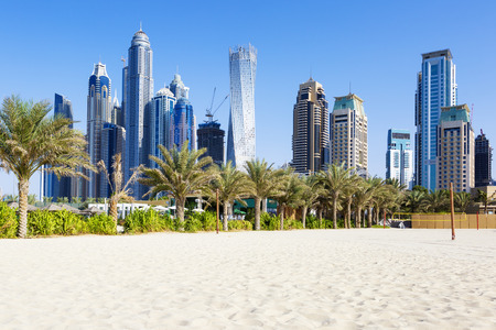 Horizontal view of skyscrapers and jumeirah beach in Dubai. UAE Archivio Fotografico
