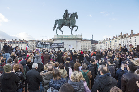 anti terrorist: LYON, FRANCE - JANUARY 11, 2015: Anti terrorism protest after 3 days terrorist attacks with people dead in Paris France, European Capital