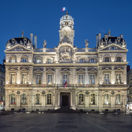 historical building: The famous Terreaux square in Lyon city by night, France. Stock Photo