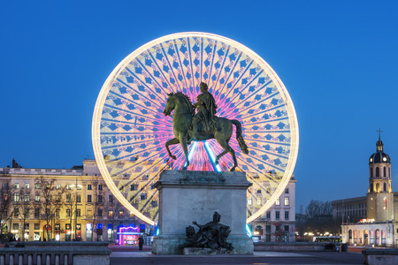 Place Bellecour statue of King Louis XIV by night, Lyon France