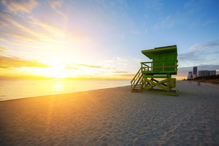 south beach: Miami South Beach sunrise with lifeguard tower, USA.