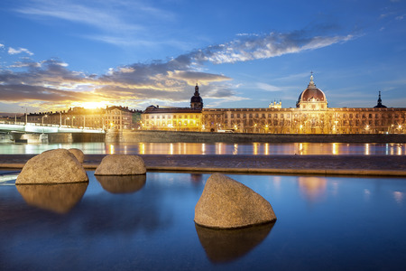 rhone: View from Rhone river in Lyon city at sunset, France. Stock Photo