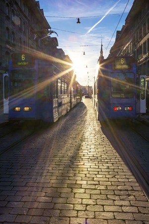 canton berne: View of Bern street with tramway at sunset.
