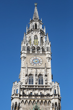 spires: Crop of Medieval Town Hall building with spires Munich Germany.