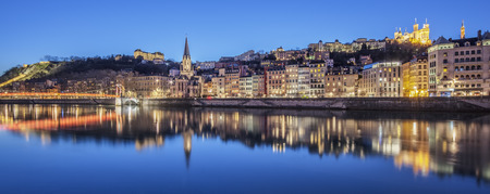 Panoramic view of Lyon with Saone river by night, France.