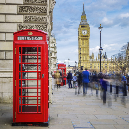 abstract london: Red phone box with Big Ben on background, London.