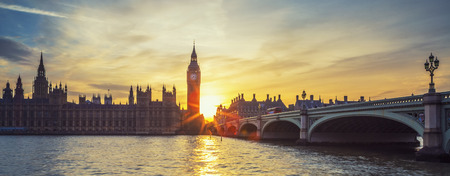 panoramic: Famous Big Ben clock tower in London at sunset, panoramic view, UK.