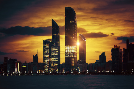skyscraper: View of Abu Dhabi Skyline at sunset, United Arab Emirates, special photographic processing. Stock Photo