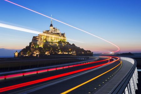michel: Mont Saint Michel at dusk with bus light, Normandy. France Stock Photo