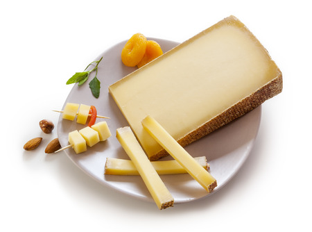 Swiss Gruyere cheese in a plate on white background Banque d'images