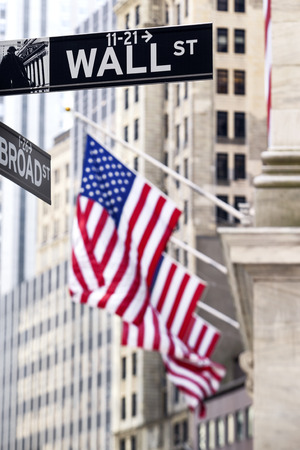 new york stock exchange: Wall street sign in New York with New York Stock Exchange background