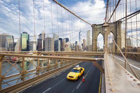 a yellow taxi: Brooklyn Bridge in New York City.