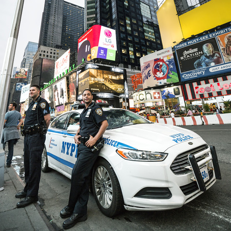 NEW YORK CITY - JULY 10: NYPD Police officers in NYC on July 10, 2015. The New York City Police Department (NYPD), established in 1845, is the largest municipal police force in the United States. Editorial