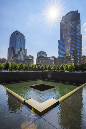 NEW YORK CITY - JULY 11: NYC's 9/11 Memorial at World Trade Center Ground Zero seen on July 11, 2015. The memorial was dedicated on the 10th anniversary of the Sept. 11, 2001 attacks