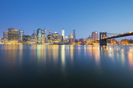 midtown: View of New York City Manhattan midtown at dusk with skyscrapers illuminated over east river Stock Photo
