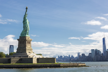 statue: Statue of Liberty and the New York City Skyline, USA.