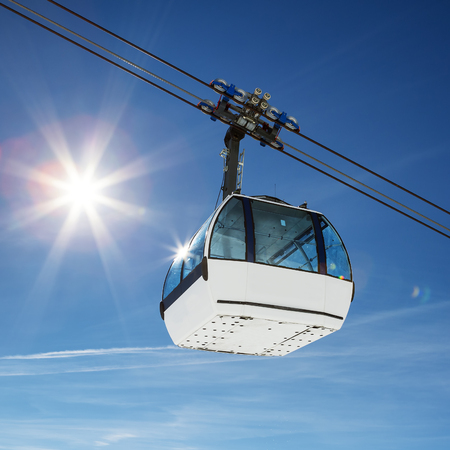 cableway: Cable car and sun in a mountain area