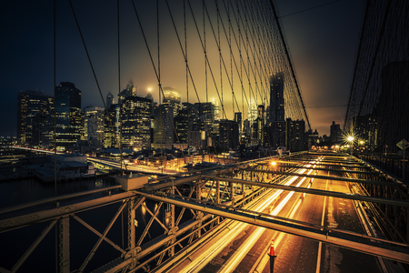 View of Brooklyn Bridge at night with car traffic