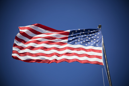 fluttering: American flag on the blue sky, USA, special photographic processing.