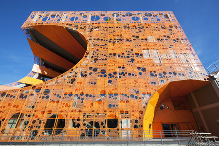 confluence: Lyon, France - November 5, 2015: Orange Cube is designed as a cube orthogonal, in which the two architects have carved a big void that meets the needs of light, air circulation and views.