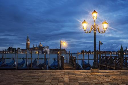 View of San Giorgio Maggiore from Venice by night, Italy. Stock Photo
