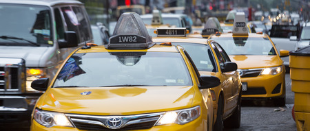 NEW YORK CITY - JULY 10: Taxi on Times Square, an iconic street of New York City and America, July 10, 2015 in Manhattan, New York City. Editorial
