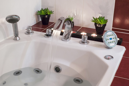 luxuriously: Jacuzzi bath with water, candles and plants