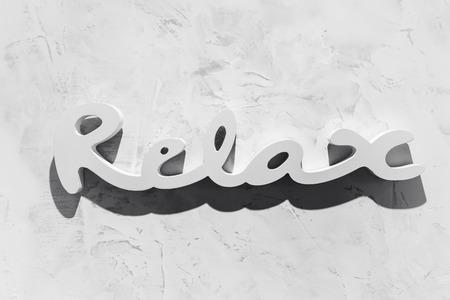 unwind: The word RELAX written in wooden letterpress type.