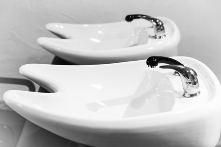 White washbasins for hairdresser Stock Photo