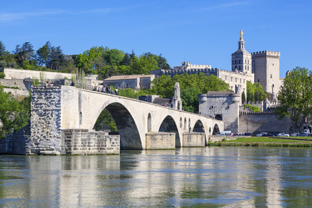 avignon: AVIGNON, FRANCE, APRIL 29, 2016 : Avignon Bridge with Popes Palace, Pont Saint-Benezet, Provence, France