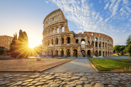 colosseum: View of Colosseum in Rome and morning sun, Italy, Europe. Stock Photo