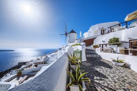 oia: Oia village with sun, Santorini island, Greece