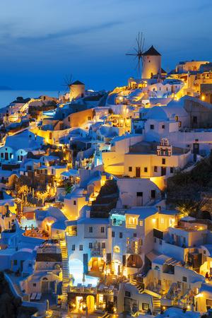 Lights of Oia village at night, Santorini, Greece.