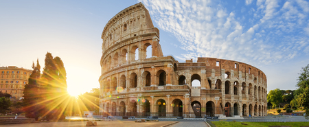 Panoramic view of Colosseum in Rome and morning sun, Italy, Europe.
