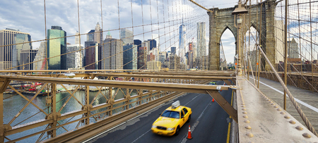 taxi famous building: Brooklyn Bridge in New York City.