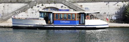 lyon: LYON, FRANCE, SEPTEMBER 8 - Vaporetto on Saone river in Lyon historic district, on september 8, 2016 in Lyon, France. Editorial
