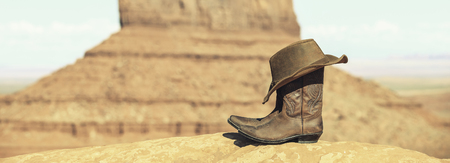 Boots and hat in front of Monument Valley with special photographic processing