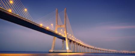 sunrise on Vasco da Gama bridge in Lisbon, Portugal Stok Fotoğraf