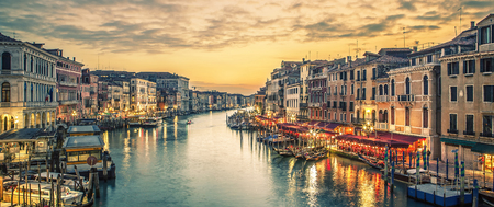 Famous grand canal from Rialto Bridge at blue hour, Venice, Italy. Special photographic processing.