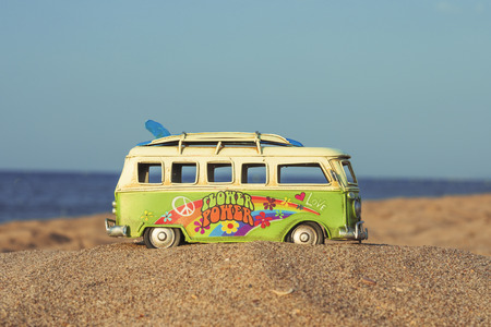 Hippie spirit with a van and long board near the sea Stock fotó