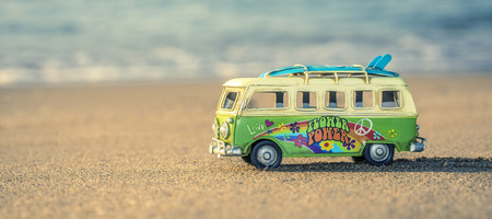 Hippie way of life with a van and long board near the sea Stock Photo