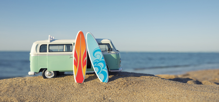 Surfing way of life with a van and long board near the sea Stock Photo