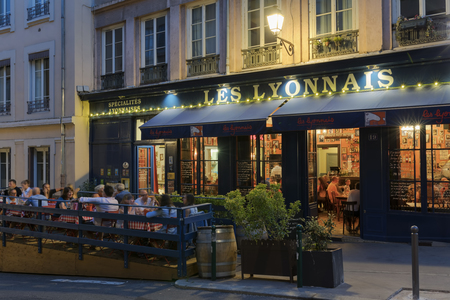 LYON, FRANCE- AUGUST 21, 2018: Bouchon -traditional local restaurant in Lyon where you eat specialties from Lyon and the region. There are 30 Bouchons in Lyon, France. Éditoriale